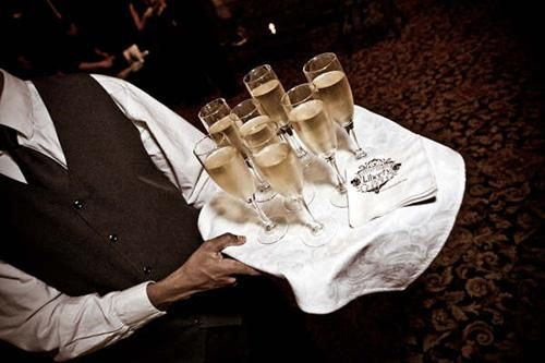 man serving champagne